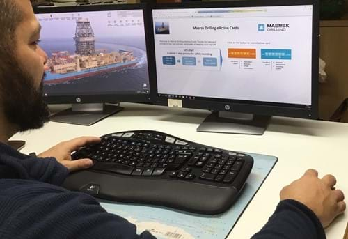 One of our employees on the Maersk Highlander illustrating how to use the Digital Reporting 'E-active Cards'